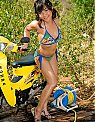 Hot Asian Babe in Bike